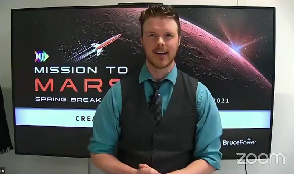 NII Explore Director Phillip Craig announces the winning team.
