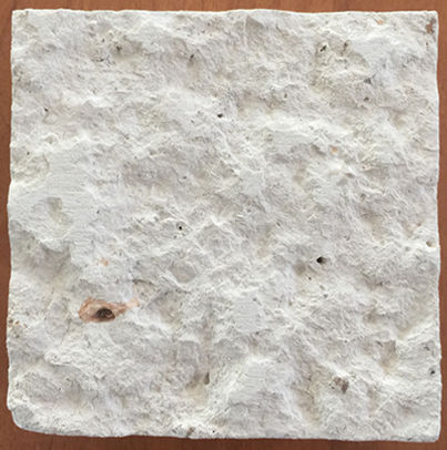 Acabado apiconado de piedra caliza campaspero