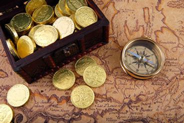 Gold coins, gold compass.