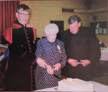 Bishop Buckley confers the 'Bene Merenti' papal medal on Maura Hegarty, Sacristan with Fr. W Dineen PP