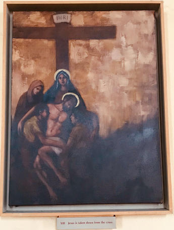 13th Station: The body of Jesus is taken down from the cross.