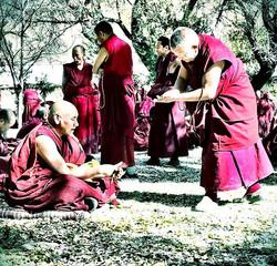 Disputing monks, the one standing presen
