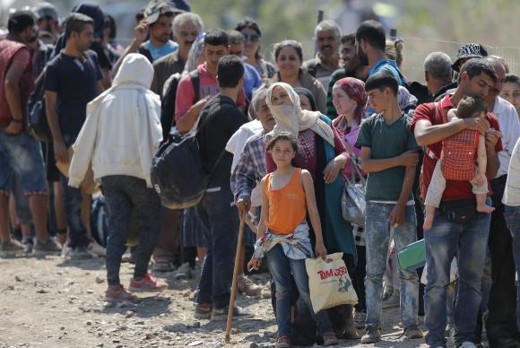 Refugiados na fronteira da Grécia com a MacedôniaValdrin Xhemaj/Agência Lusa