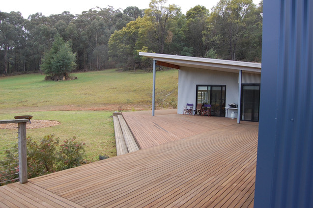 View across the deck to the doors of the yoga room
