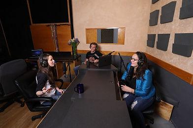 Postcast host interviews musical artist at Harvest Moon Studios in Martinez, CA.