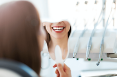 Cross Creek Dental, Lorena TX Woman Smiling in Mirror