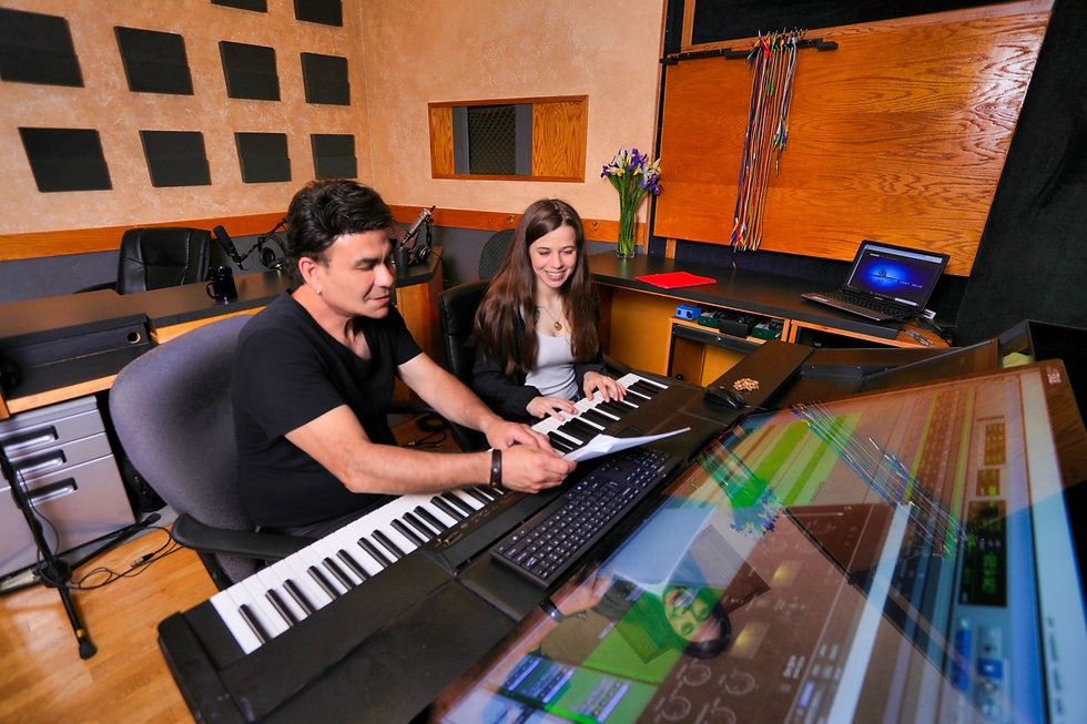 Music engineer and producer working with an artist to create the perfect sound at Harvest Moon Studios.
