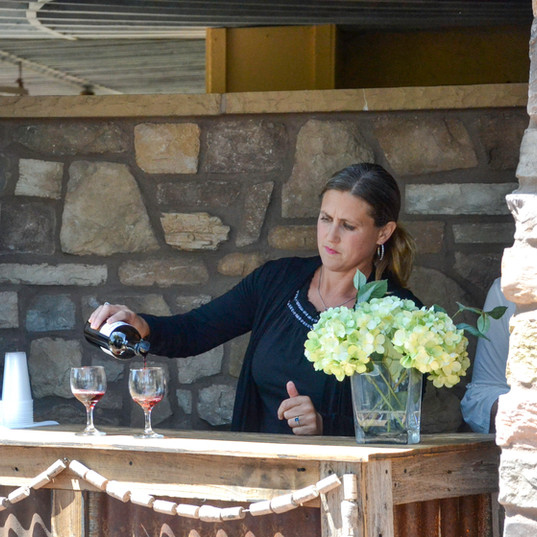 Rancho Roble Pouring Wine at a Wine Tasting