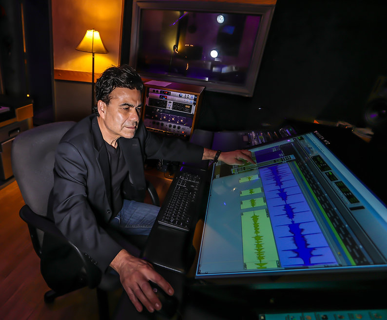 Michael Peterson is at the console editing a track at Harvest Moon Studios.
