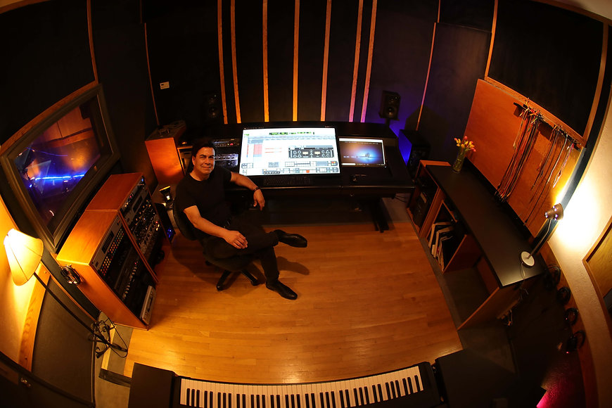 Producer, Michael Peterson in the first class control room at Harvest Moon Studios.