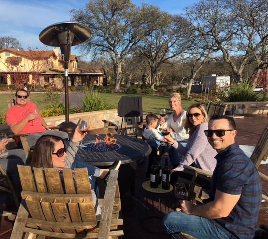 Rancho Roble Families Tasting Wine By the Fire