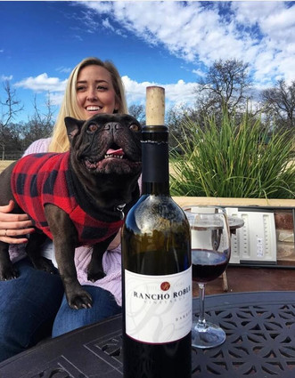 Rancho Roble Woman With a Dog and a Bottle of Wine