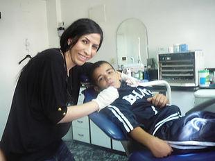 Beautiful Smiles Dentistry Roseville CA Dentist Helping Child