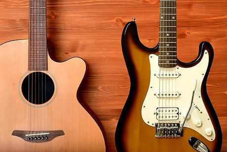 acoustic and strat on blond wood.jpg