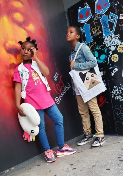 Latifah Saafir designed a tote bag and unicorn travel pillow, modeled by her niece and nephew, as part of her Quilt Cadet patterns for kids. (Halimah Saafir)