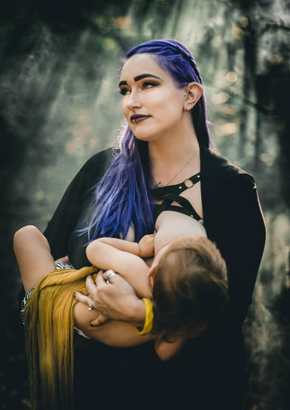 Breastfeeding mother in the woods