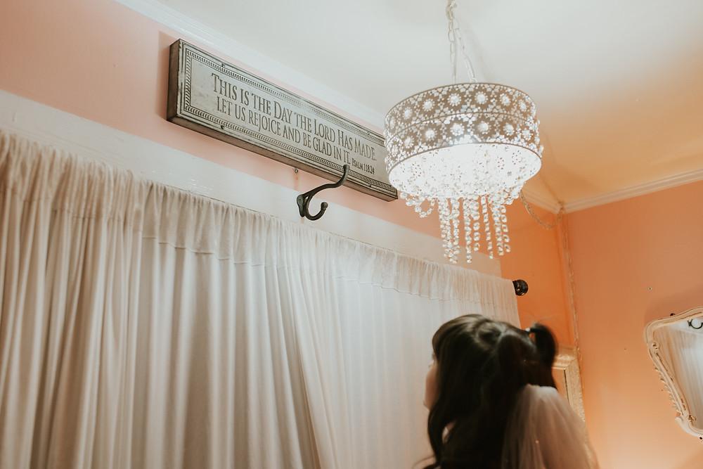 woman looking up at prayer sign