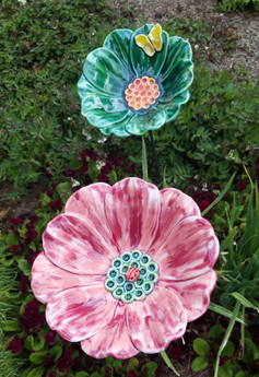 Large Garden Flowers with instects. Become water bowls for birds when rainy.