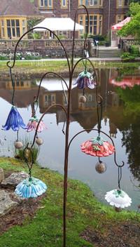 Hanging Ceramic Flower Bird Feeders at Bristol Botanic Gardens by Renee Kilburn Ceramics