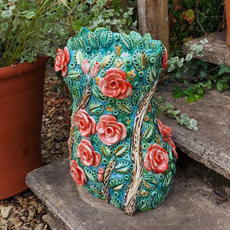 Aurora Female Torso Stoneware Garden Sculpture with Red Roses by Renee Kilburn Ceramics.