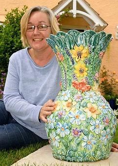 Renee Kilburn Posing with Ceramic Garden Sculpture for Interview with Weston Mercury