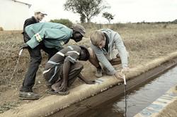 Instrumenting gauging sites in Nhamandeme Irrigation Scheme.