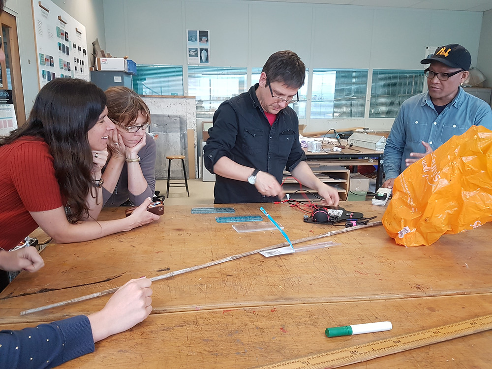 Testing conductivity of copper powder fused in glass