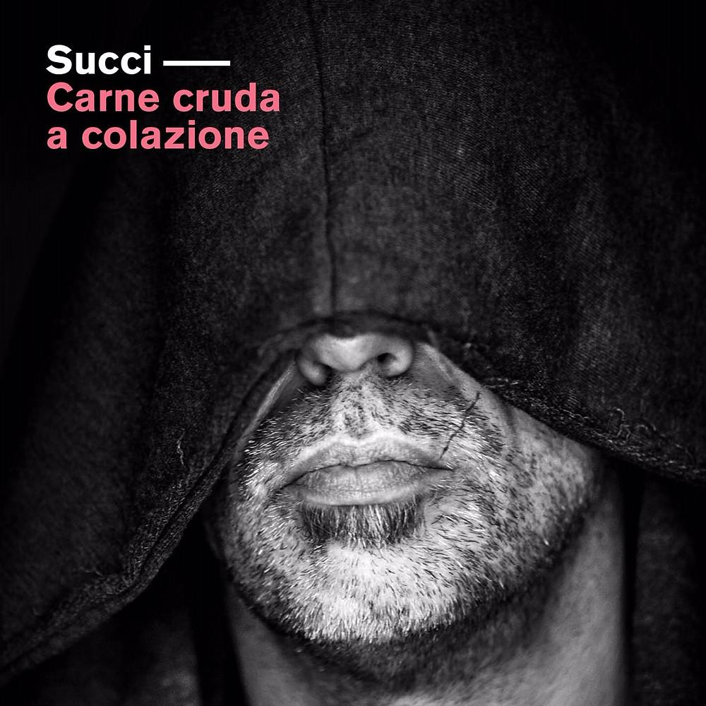 """La copertina dell'ultimo album di Succi, """"Carne cruda a colazione"""""""