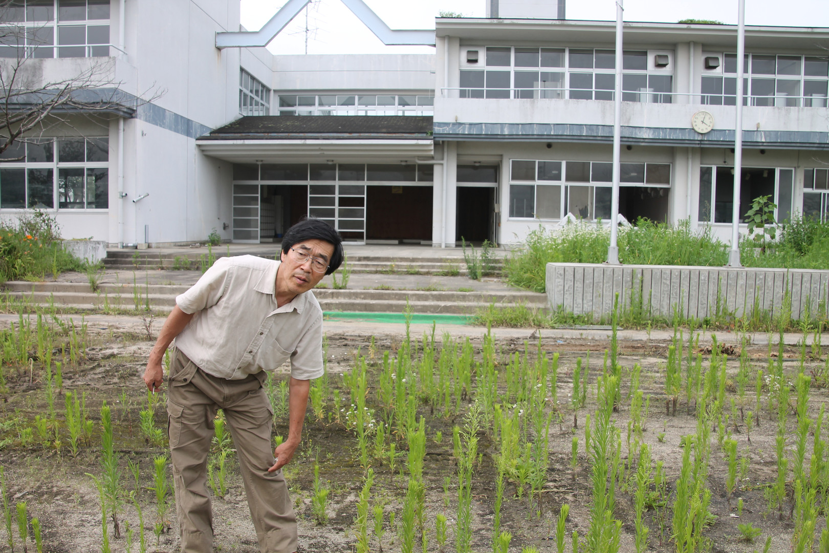 Farmer Otomo showing how high the water