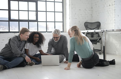 group-of-people-working-while-seated-on-