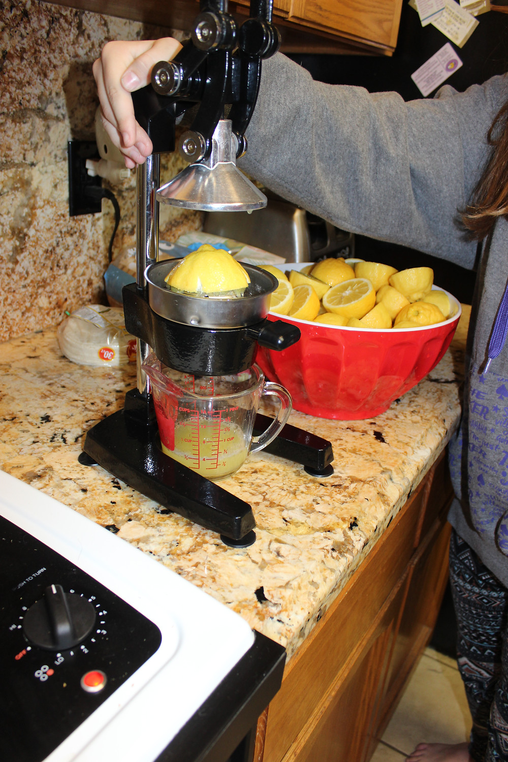 My little sister in law using the press juicer to squeeze lemons