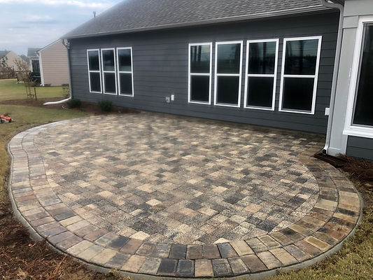Back patio pervious pavers by Tremron