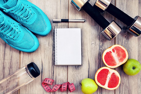 Fitness equipment. Healthy food. Sneaker