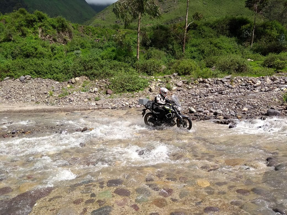 Victor completing a water crossing on route from Huaral to Bosque de Piedras