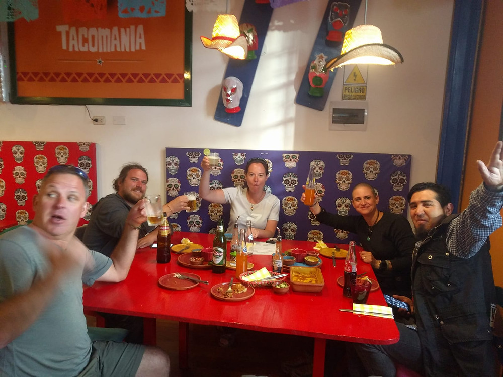 Kelvin got sidetracked, Gus, Me chewing, Aida and Ruben enjoying Mexican food in Cusco. Tacomania.  AvVida.co.uk. Photo by Suzie Bostock.