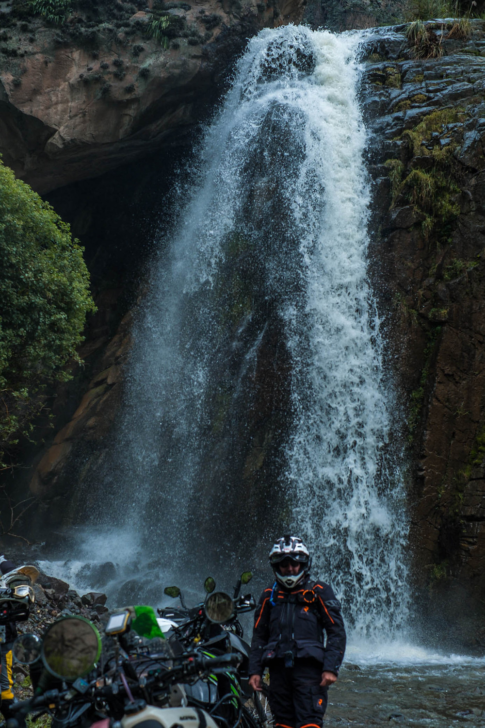 Kelvin at a cool waterfall above a long water crossing on route to Nevada del Rajuntay - #RukkaMotorsport