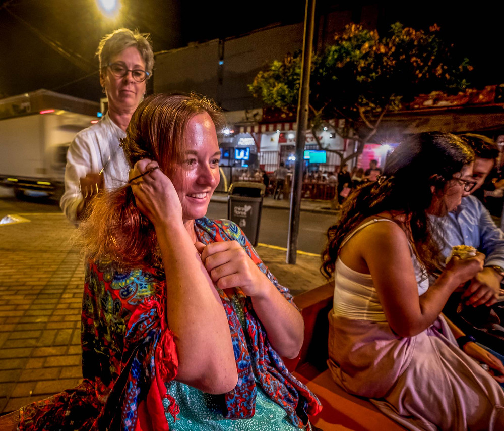 Caren cutting my hair on the street in Lima