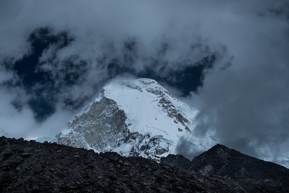 One of the towering snow-capped mountains next to Lake Paron