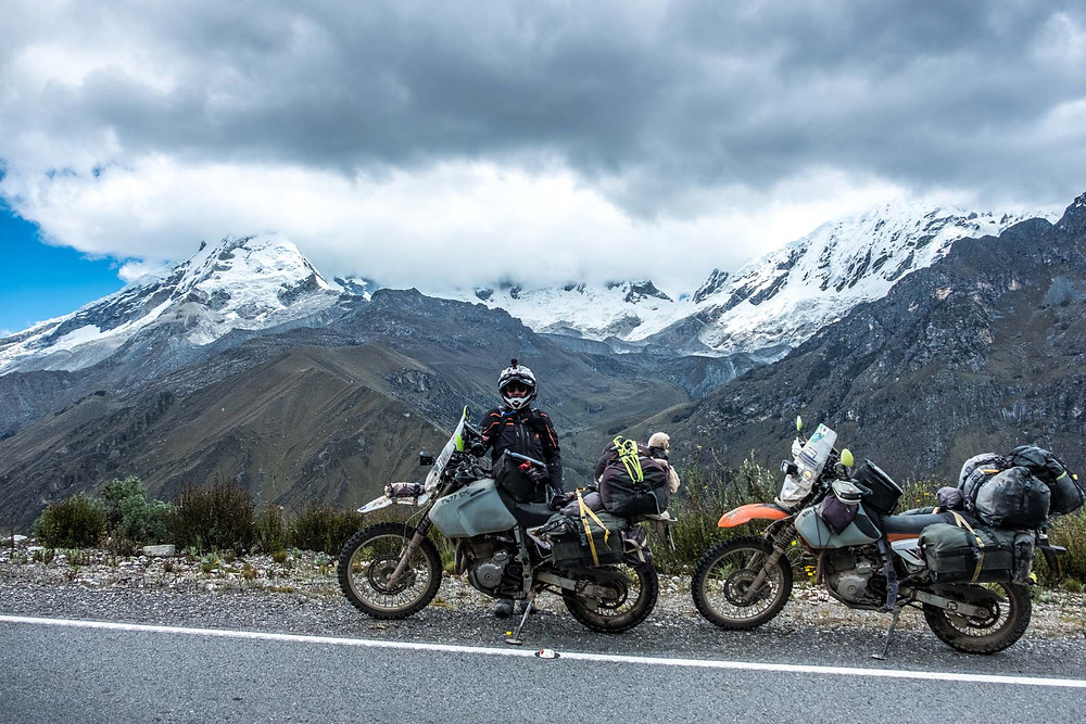 Kelvin near the top of the pass before Punta Olympica with an amazing backdrop - #RukkaMotorsport
