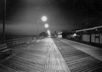 Asbury Park boardwalk at dawn, in b&w