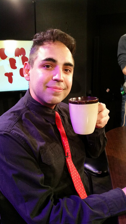 Matt at the Denver Open Media 24 hour telethon drinking a cup of coffee.