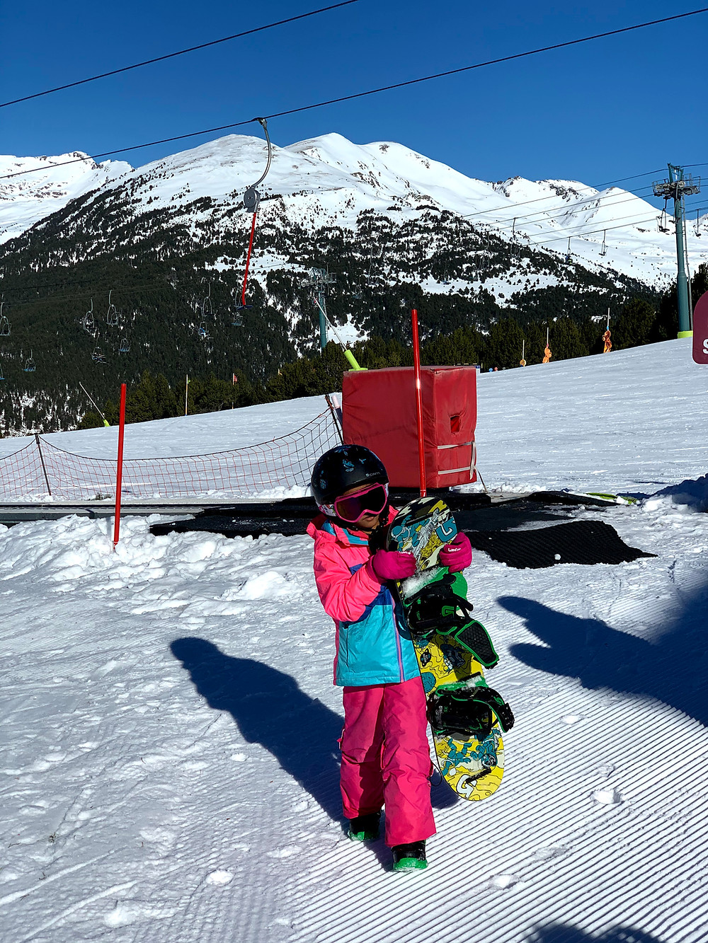 Hi, I am Zazi, a young snowboard gril. Here I am ready to go snowboarding for the first time ever :-).