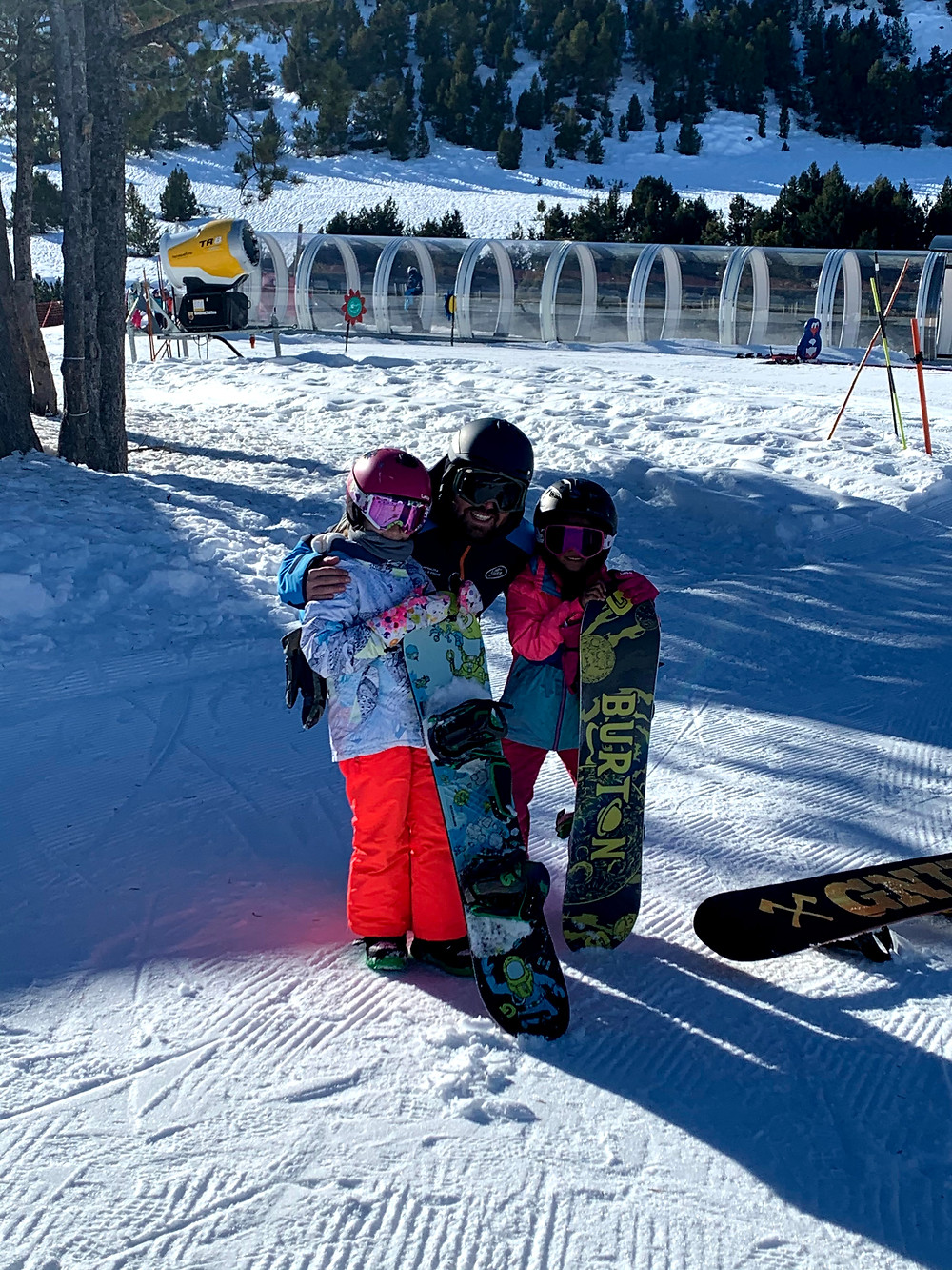 Hi, I am Zazi, a young snowboard gril. Here I am with our teacher Carlos and my best friend Cristina. We went snowboarding for the first time. He was a great teacher.