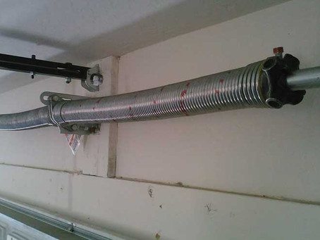 7 Warning Signs You Need  Garage Door Spring Repair