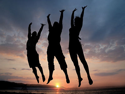 Three people jumping - fit and healthy from Reiki