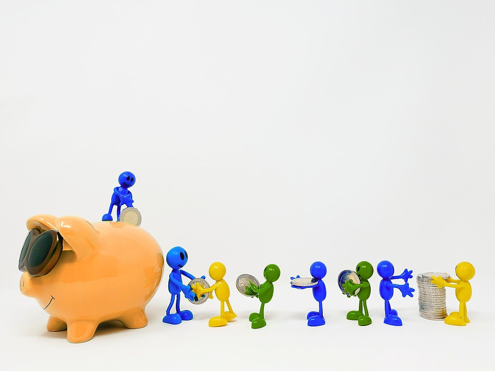 small tiny people are saving money in piggy bank