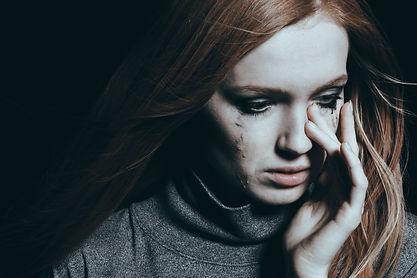 beautiful-woman-covering-tears-PJXV59D.j