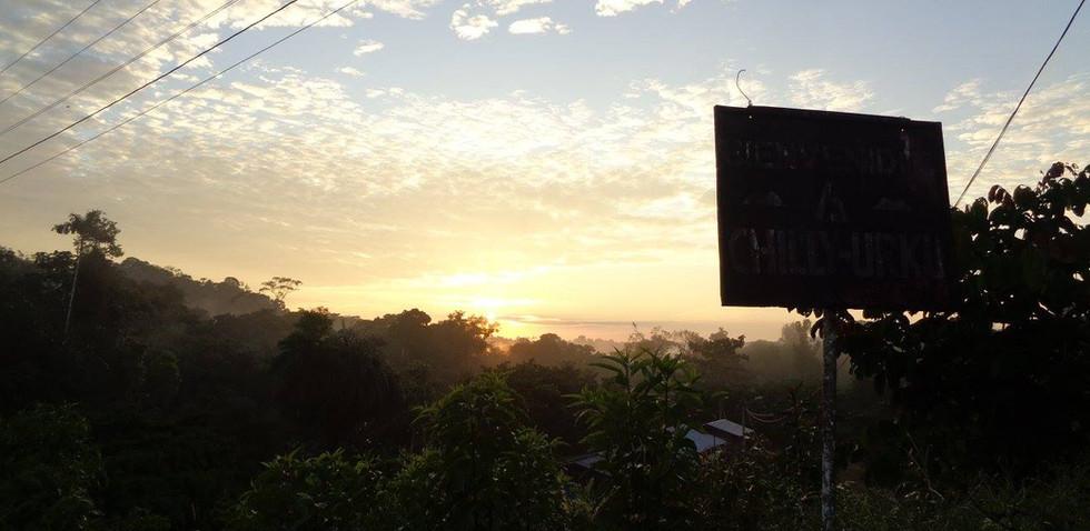 Chili Urku trek sunrise over rainforest.