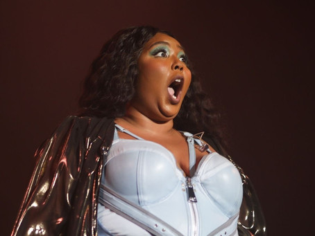 Lizzo sued by Postmates driver she accused of stealing food
