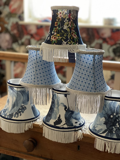 Various small lampshades in blues